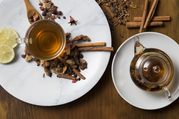 Food background with different black and green dry tea, rose buds cup of hot tea