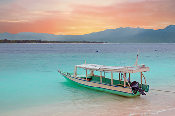 Traditional boat on Gili Meno island beach, Indonesia at sunset