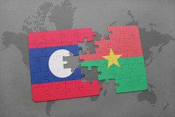 puzzle with the national flag of laos and burkina faso on a world map