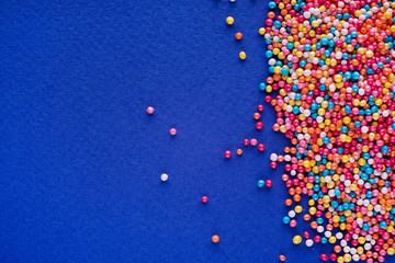 Colorful Easter background, sprinkles on blue background