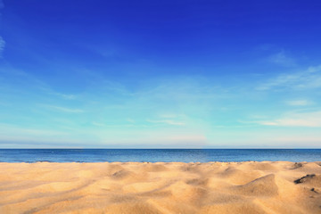 Sand on seaside under blue clear sky