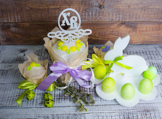 Easter cakes with bright decoration and painted eggs