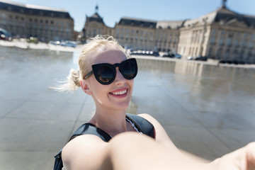 A portrait of a Happy young caucasian woman take selfie, smile to camera