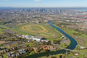 Aerial view of Flemington Racecourse with Melbourne CBD in background (Victoria, Australia)