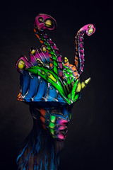 Mannequin girl in airbrush mask and headwear