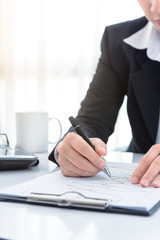 Business man working at office and documents on she desk