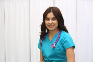 Portrait of a young attractive hispanic healthcare worker. Nurse in medical clinic.