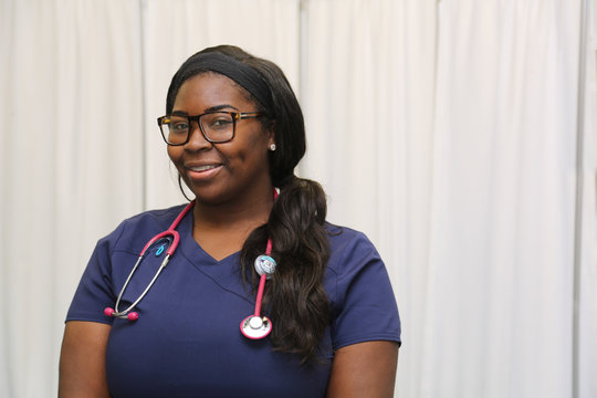 Portrait of a happy African American female healthcare professional, portrait of a nurse with stethoscope