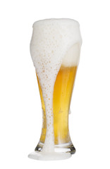 Closeup of  overflowing glass cup of beer.