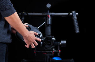 Hand held camera stabilizer
