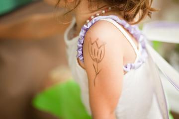 Henna ornaments on girl's hand