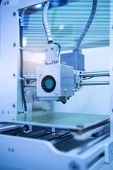 3D printer on a blue background