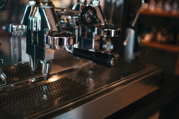 Close up of metal stylish coffee machine