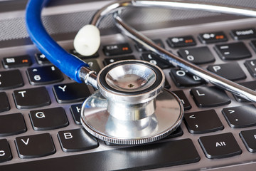 Medical stethoscope and laptop