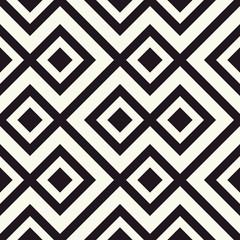 Tile floor in geometrical seamless pattern in beige and black tones