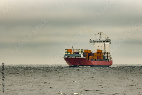 Red Cargo Container Ship Sailing From Baltic Sea In