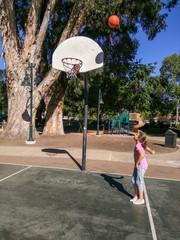 Basketball in park