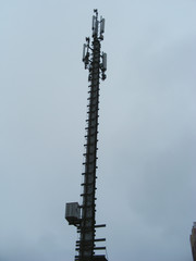 Mast of cellular communication with microwave radio antenna equipment in Belarus