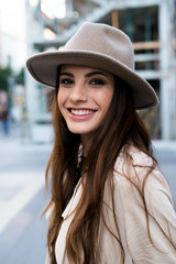 Young smiling woman wearing hat
