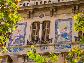 Facade of the building with a mosaic picture on external wall in Palma De Mallorca