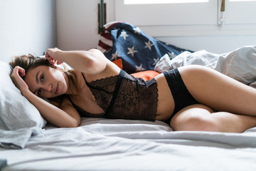 Young pretty girl on the bed