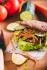 Vegetarian sandwich with lettuce, cucumber, carrot tomato anda avocado