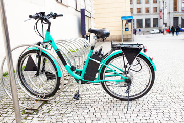 Modern Electric bike at bicycle parking alone on the old city street