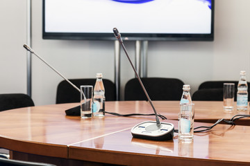 Table with microphones at the conference, in the classroom or at the training