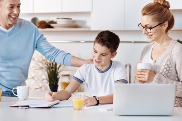 Loving parents helping his son with homework