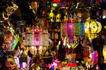 Vibrant colourful handmade tin lamps on medina market