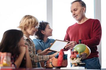 Enthusiastic original teacher awarding his students