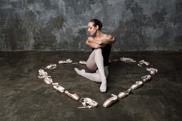 Ballerina sitting inside heart made of pointe shoes