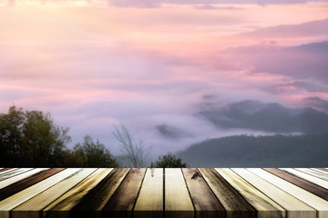 Empty wooden table with blurred sea mist and mountain background. Product display template