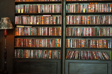 Old vintage books in bookcase. Knowledge in library