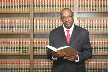 Lawyer in law library with copy space
