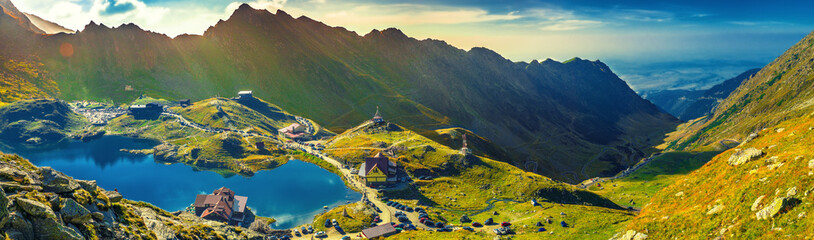 Transfagarasan Balea glacier lake, panoramic view - Lake, is a glacier lake situated at 2.034 m. of altitude in the Mountains, in central Romania, Sibiu County.