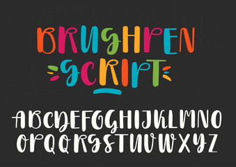 White and colored capital handwritten vector brush pen alphabet on black background.