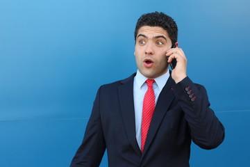 Shocked man on a phone conversation