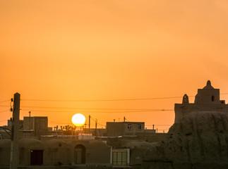 View on orange sunset over village in iran