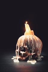 High contrast image of skull with candle on top