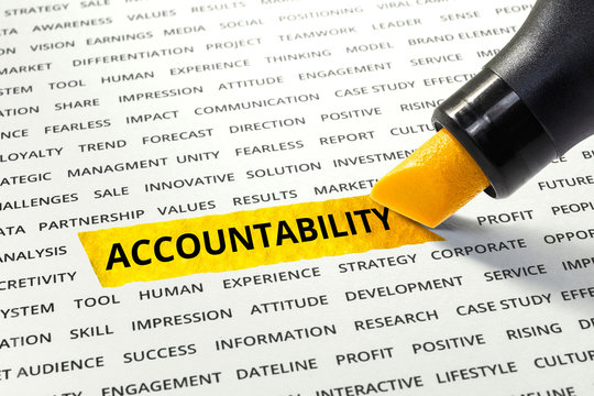Word Accountability highlighted with marker on paper of other related words.business concept.