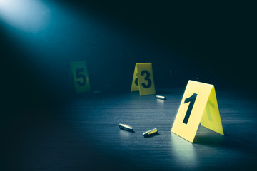 Crime scene with evidence markers on a dark background