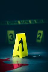 Fototapeta Crime scene with evidence markers on a dark background