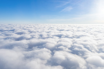 Fototapeta View from airplane window above the clouds obraz