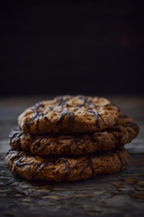 Oatmeal cookies on a wooden texture