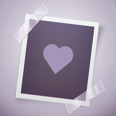 Retro photo frame with heart. Romantic concept. Happy Valentine day motive.
