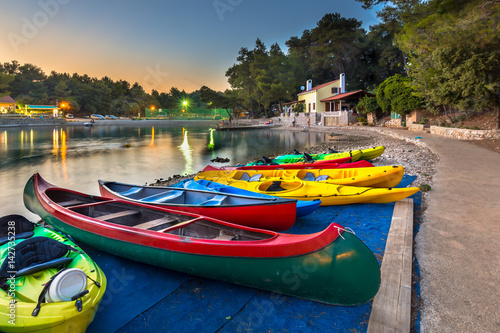 Wall mural Colorful Kayaks for rent