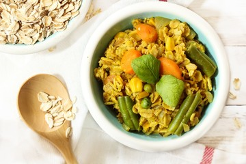 Masala Oats Upma - Healthy breakfast, selective focus