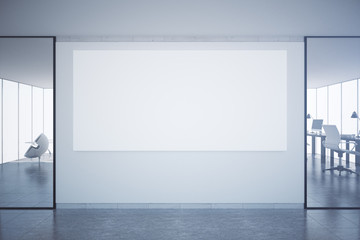 Office with blank poster