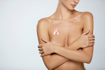 Naked Woman With Breast Cancer Awareness Ribbon On Chest